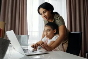 Mother helping child home school
