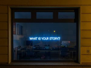 Image with sign reading 'What is your story?'